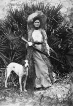 Woman with Dog and Shotgun